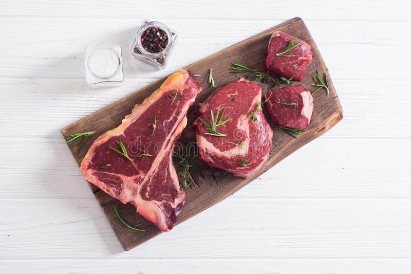 Variety of raw beef meat steak. T-bone , ribeye and fillet mignon . Black angus royalty free stock photo
