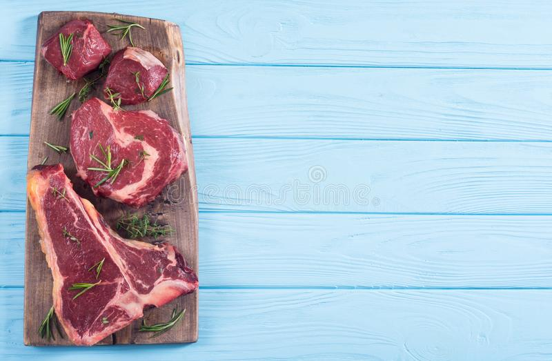 Variety of raw beef meat steak. T-bone , ribeye and fillet mignon . Black angus royalty free stock photos