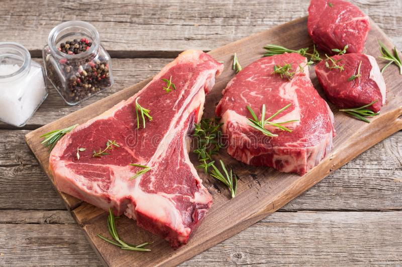 Variety of raw beef meat steak. T-bone , ribeye and fillet mignon . Black angus stock image