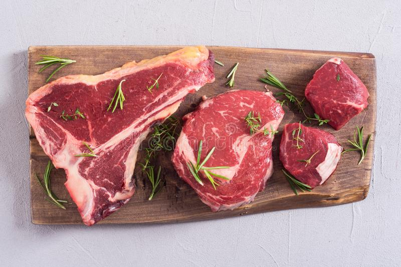 Variety of raw beef meat steak. T-bone , ribeye and fillet mignon . Black angus stock photography