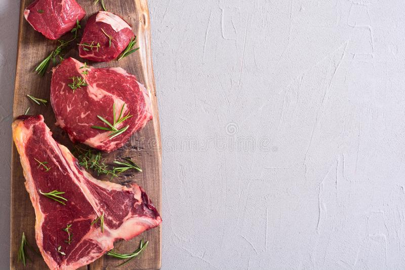 Variety of raw beef meat steak. T-bone , ribeye and fillet mignon . Black angus royalty free stock photography