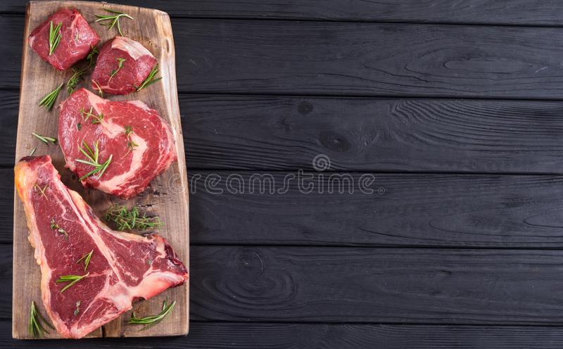Variety of raw beef meat steak. T-bone , ribeye and fillet mignon . Black angus stock photos