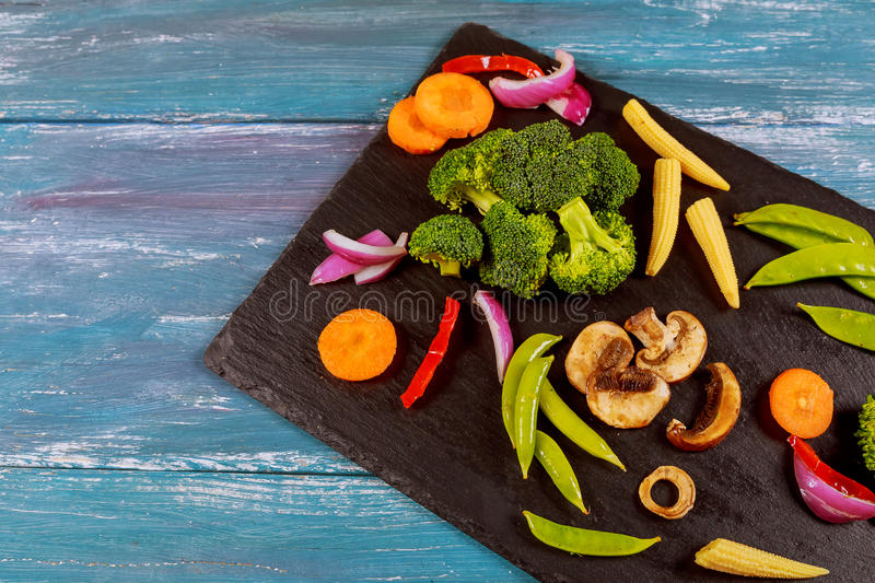 Variety of raw green vegetables salads, lettuce, bok choy, corn, broccoli, savoy cabbage, colorful young carrots and cauliflower o stock photos
