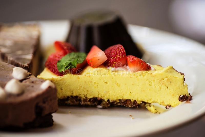 Variety of raw vegan desserts royalty free stock image