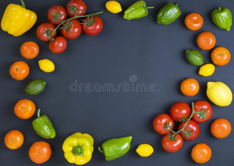 Variety of raw vegetables, culinary concept. Assortment of vegetables and herbs on grey stone background. Top view. Copy space. Di. Fferent raw vegetables and royalty free stock photography