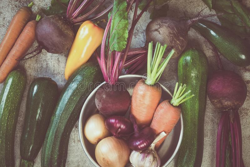Variety of raw vegetables on old table. View from above. Vegetarian food, health or cooking concept. royalty free stock images