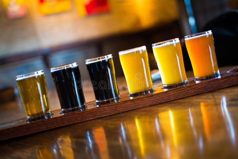 A variety set of craft beers light and dark. On the table stock photography