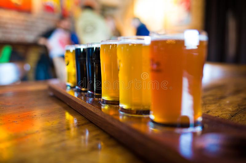 A variety set of craft beers light and dark. On the table royalty free stock images