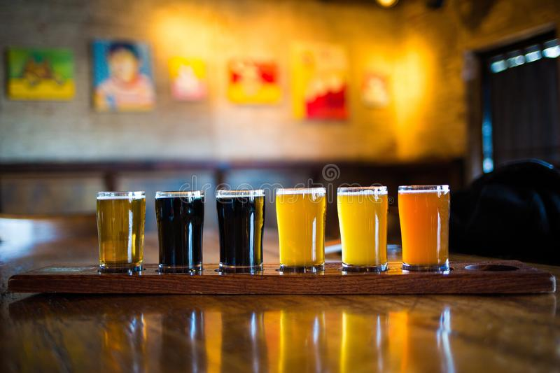 A variety set of craft beers light and dark. On the table royalty free stock photo