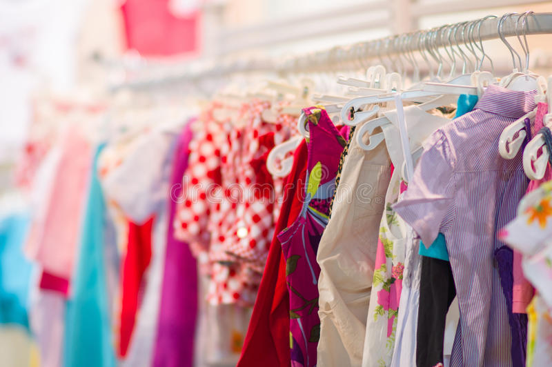 Variety of shirts, trousers, dresses in kids mall. Variety of shirts, trousers, dresses in mall stock image