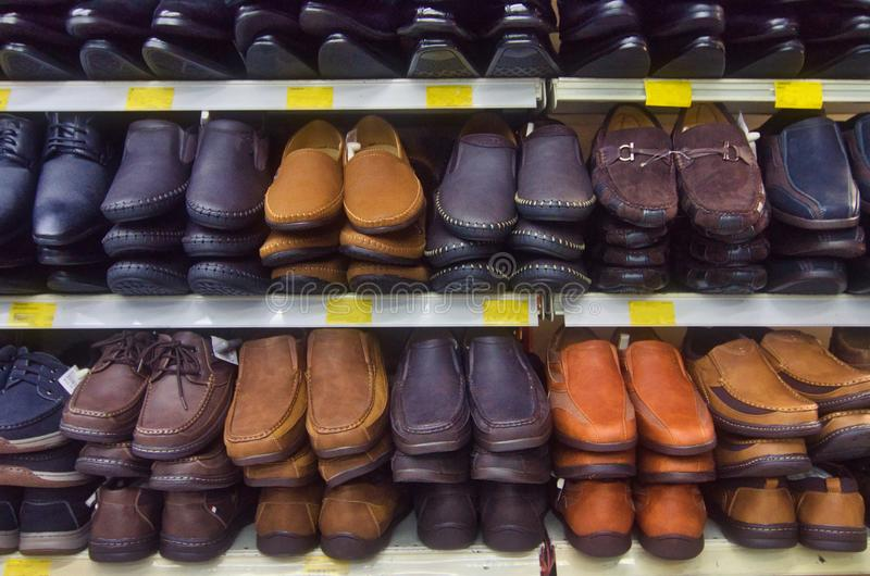Variety shoe for man display on shelf in the store royalty free stock photo