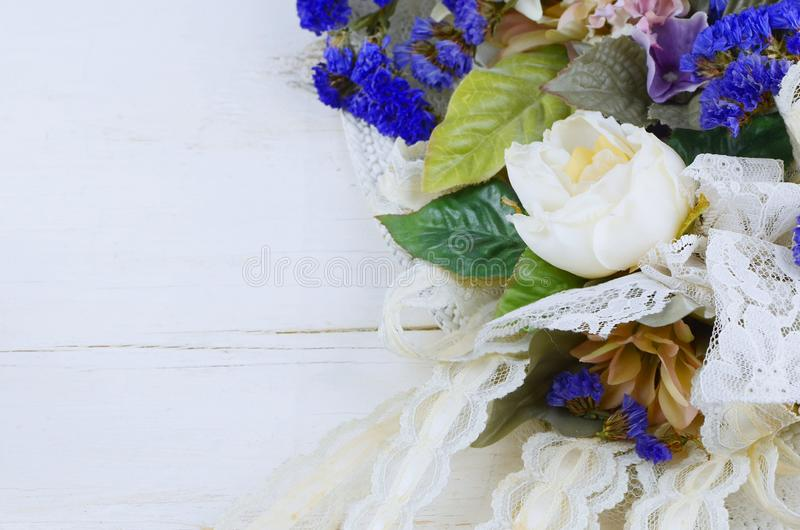 A variety of silk and dried flowers combines with lace is a feminine image good for anniversary, wedding, mother`s day or birthday stock images