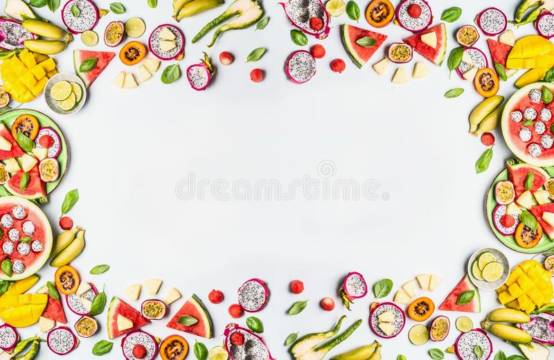 Variety of slices fruits on white background. Colorful fresh fruits. Flat lay, top view, copy space stock photography
