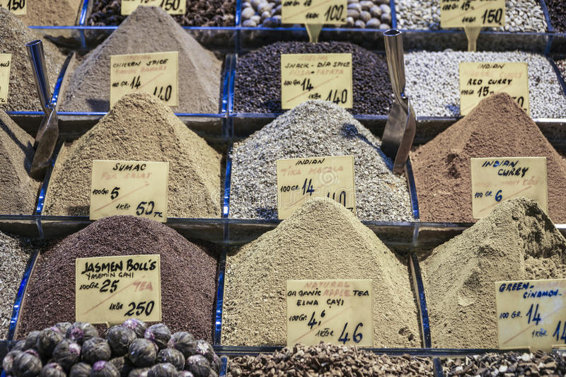 Variety of spice piles at bazaar stock photo