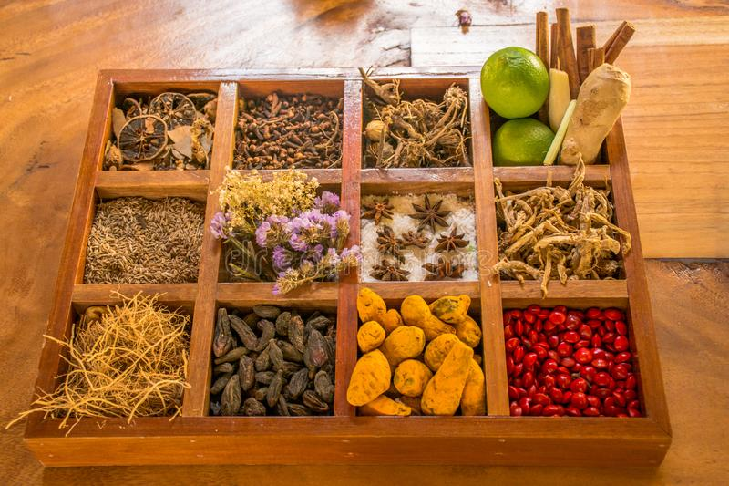 Variety of spices and condiments in the wooden box on the table stock photos