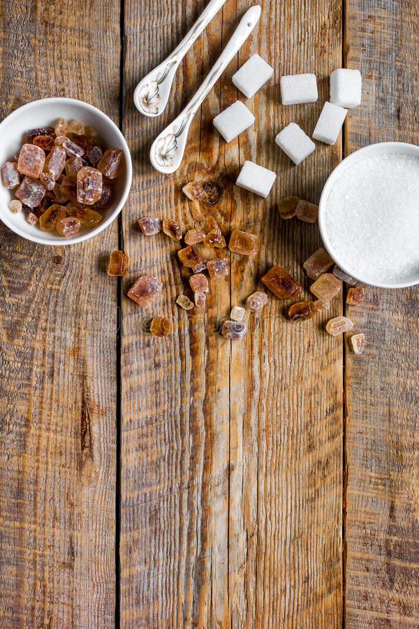 variety of sugar in bowls on wooden table background top view space for text stock photos