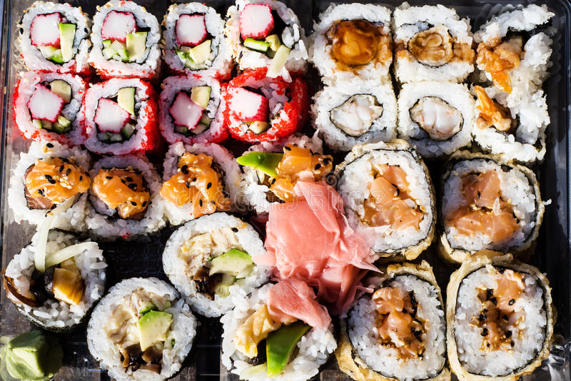 Variety of sushi in a delivery box royalty free stock photos