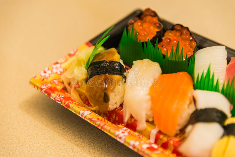 Variety sushi in plastic plate from supermarket with selective focus stock image