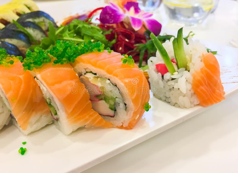 Variety of sushi rolls on a white plate royalty free stock photo