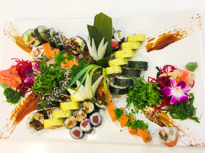 Variety of sushi rolls on a white plate stock photos