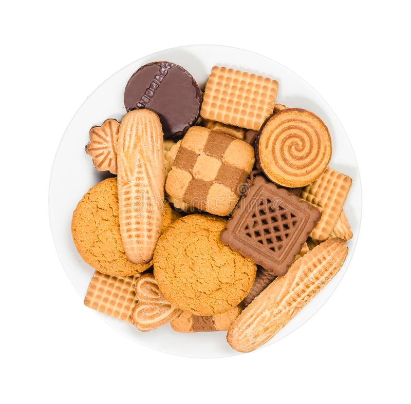 Variety of sweet cookies on a plate on white background, top view royalty free stock photography