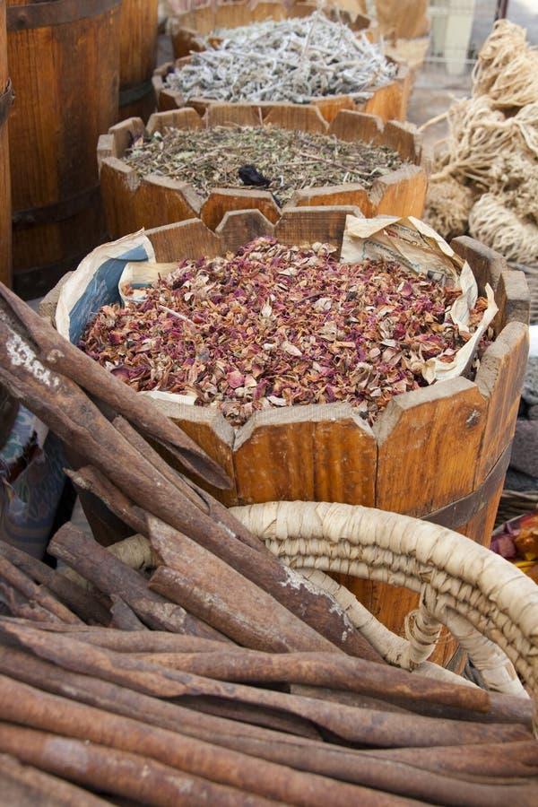 Variety of Tea and Herbs in buckets. Cinnamon, tea and herbs in buckets on a market in Egypt royalty free stock photo