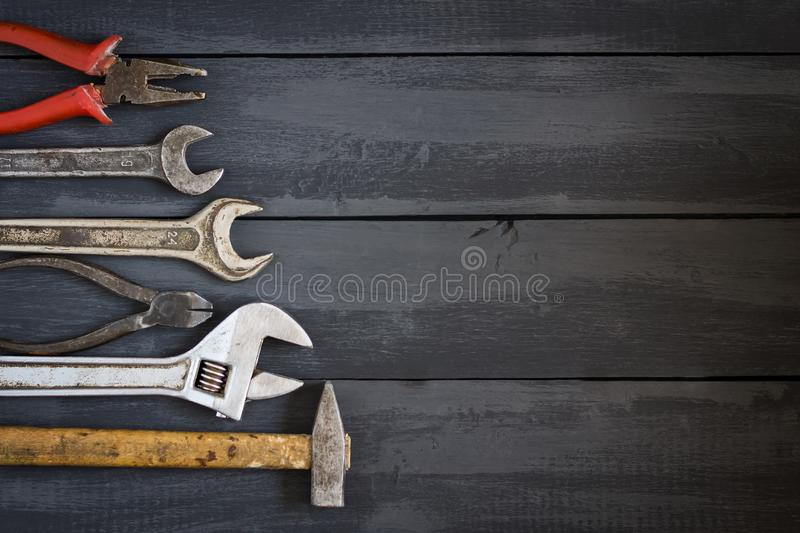 Variety of tools for wrenches on a dark wooden table. Copy space. Concept Happy Father`s Day. stock photo