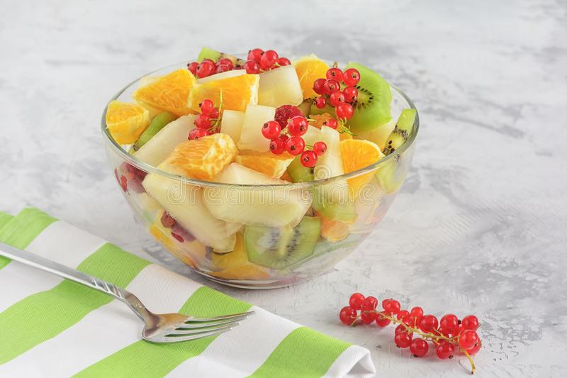 Variety Tropical Fruit and Berry Salad Glass Bowl stock photo