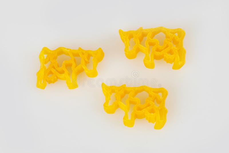 Pasta in shape of animals on a white background. Cows, domestic animals royalty free stock photo