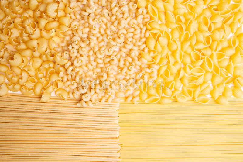 Variety of types and shapes of Italian pasta. Dry pasta background royalty free stock image
