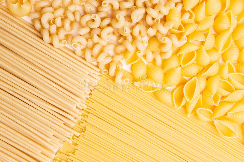 Variety of types and shapes of Italian pasta. Dry pasta background royalty free stock photo