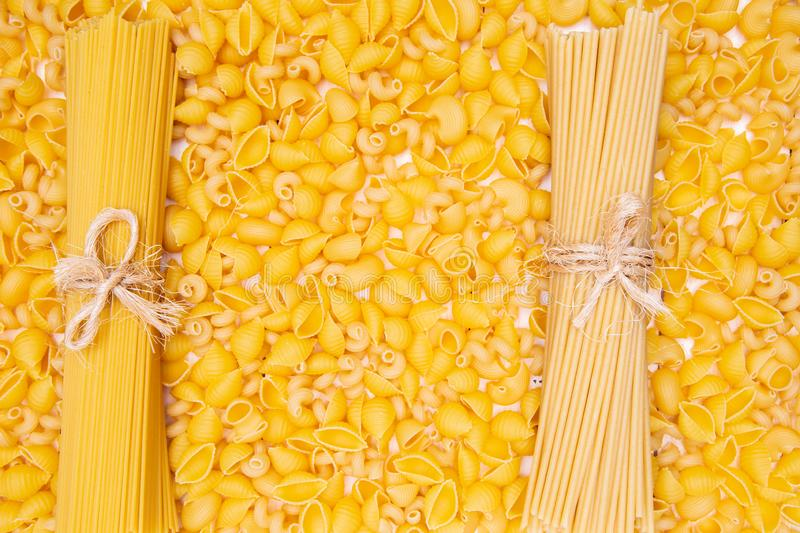 Variety of types and shapes of Italian pasta. Dry pasta backgrou royalty free stock images