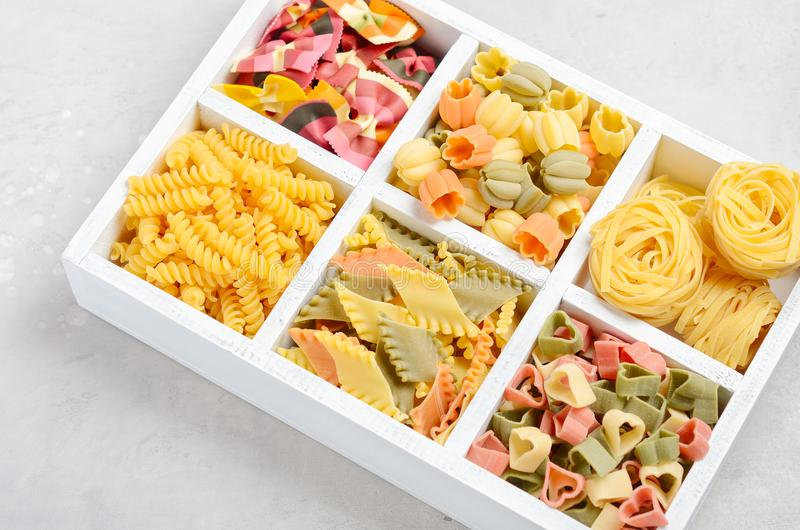 Variety of types and shapes of raw Italian pasta. Selective focus stock photo
