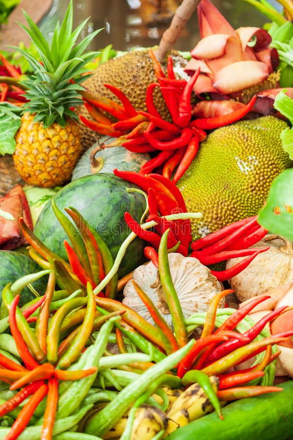 Variety of vegetables and fruit. Colorful and Fresh, chili pepper, pineapple, pumpkin, banana bud, and other tropical vegetables. stock photo
