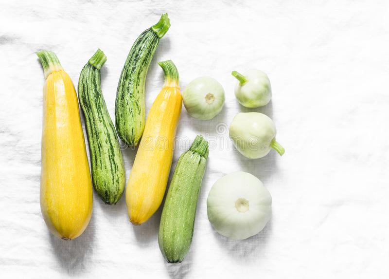 Variety zucchini, squash on a light background, top view. Vegetarian diet food concept. royalty free stock images