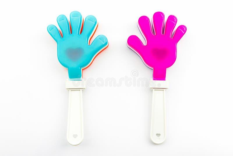Variopinto del giocattolo di applauso della mano, mani di plastica del giocattolo fotografia stock