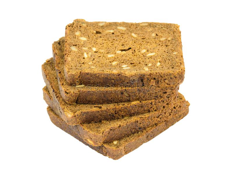 Varios pedazos de pan con los cereales aislados en un fondo blanco imágenes de archivo libres de regalías