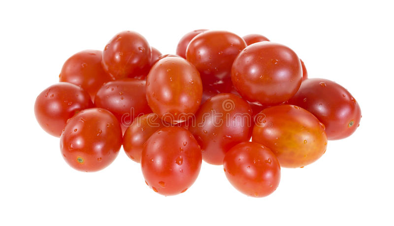 Los tomates de la uva todavía humedecen fotografía de archivo