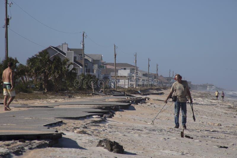 Various activities at beach after Hurricane Matthew. People doing various activities after Hurricane Matthew stock photos