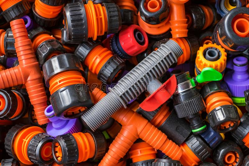 Various adapter for watering hoses on the garden market. royalty free stock photos