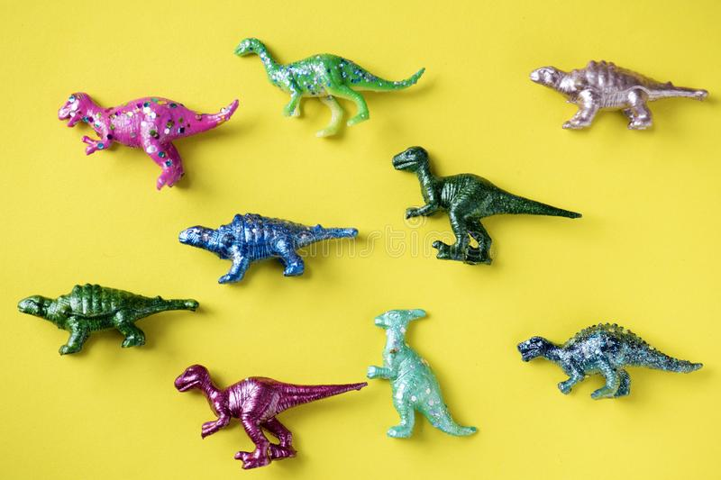 Various animal toy figures in a colorful background stock photo