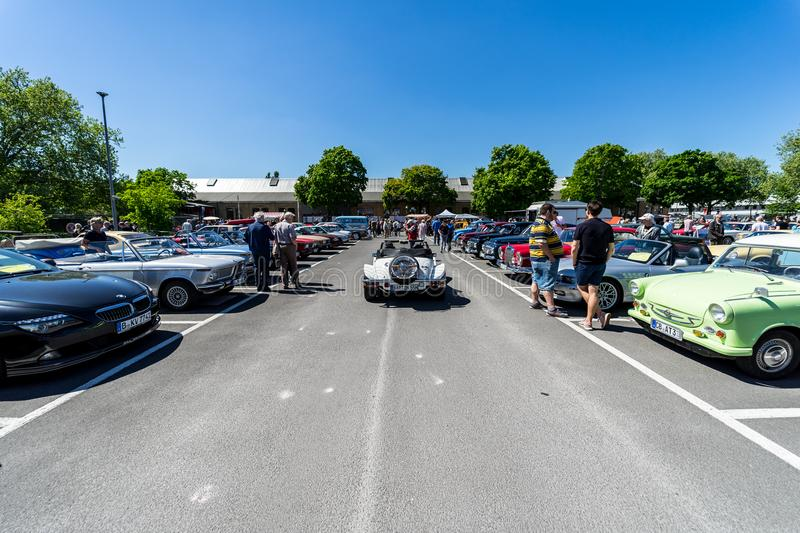 Various antique cars parked in front of the Classic Remise Berlin building. royalty free stock photos