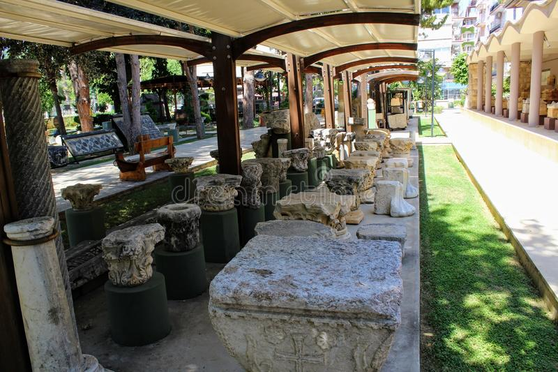 Various antique exhibits in the courtyard of the Alanya Archaeological Museum Turkey royalty free stock image