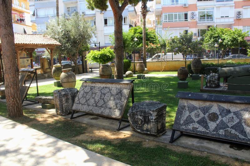 Various antique exhibits in the courtyard of the Alanya Archaeological Museum Turkey royalty free stock photos