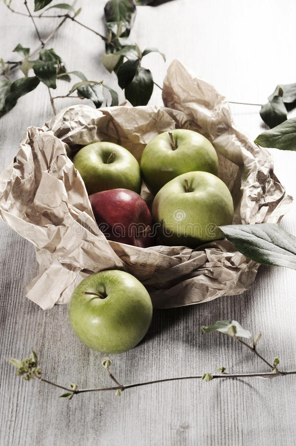 Various apples on a wooden tabletop royalty free stock photo