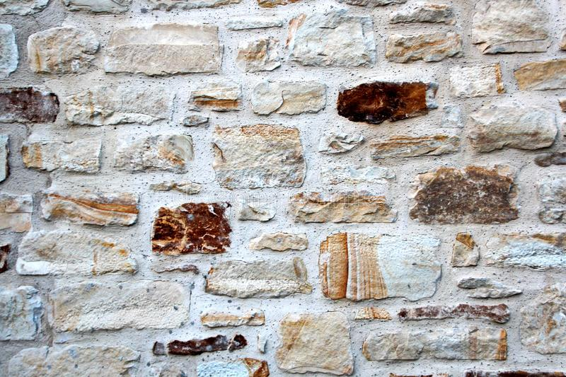 Various background types of laying stones from granite and other materials used in the construction. Of old buildings and structures royalty free stock photos