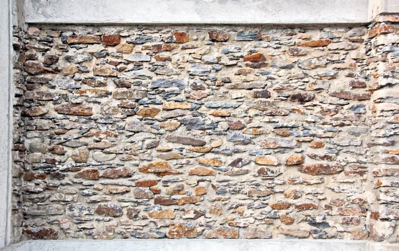 Various background types of laying stones from granite and other materials used in the construction. Of old buildings and structures stock images