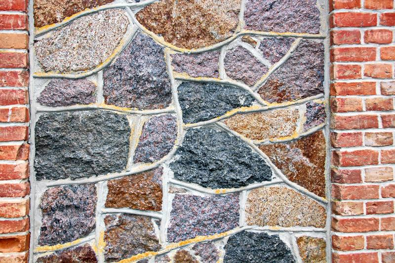 Various background types of laying stones from granite and other materials used in the construction. Of old buildings and structures royalty free stock images