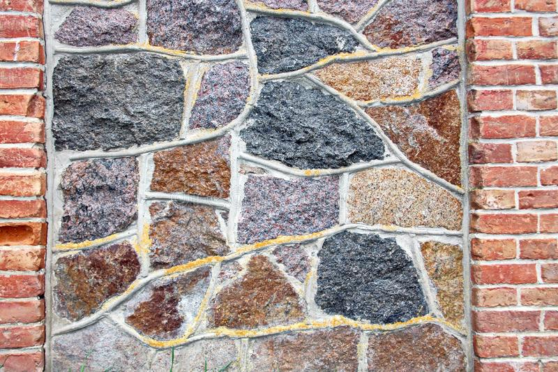Various background types of laying stones from granite and other materials used in the construction. Of old buildings and structures royalty free stock image