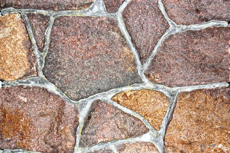 Various background types of laying stones from granite and other materials used in the construction. Of old buildings and structures royalty free stock photo